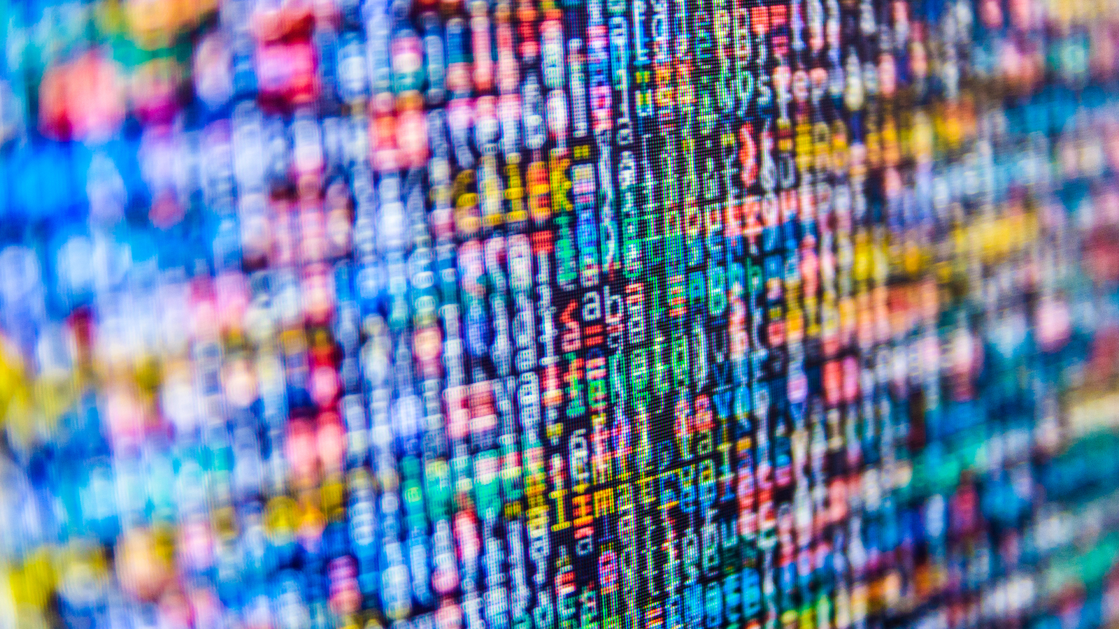 Photo of multicoloured code on screen.