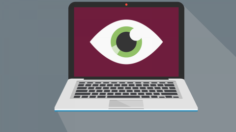 Illustration of green eye on burgundy laptop screen.