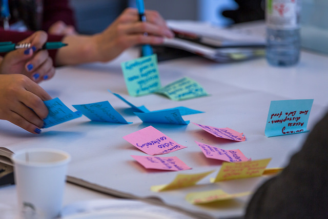 Photo of coloured post-it notes on table.