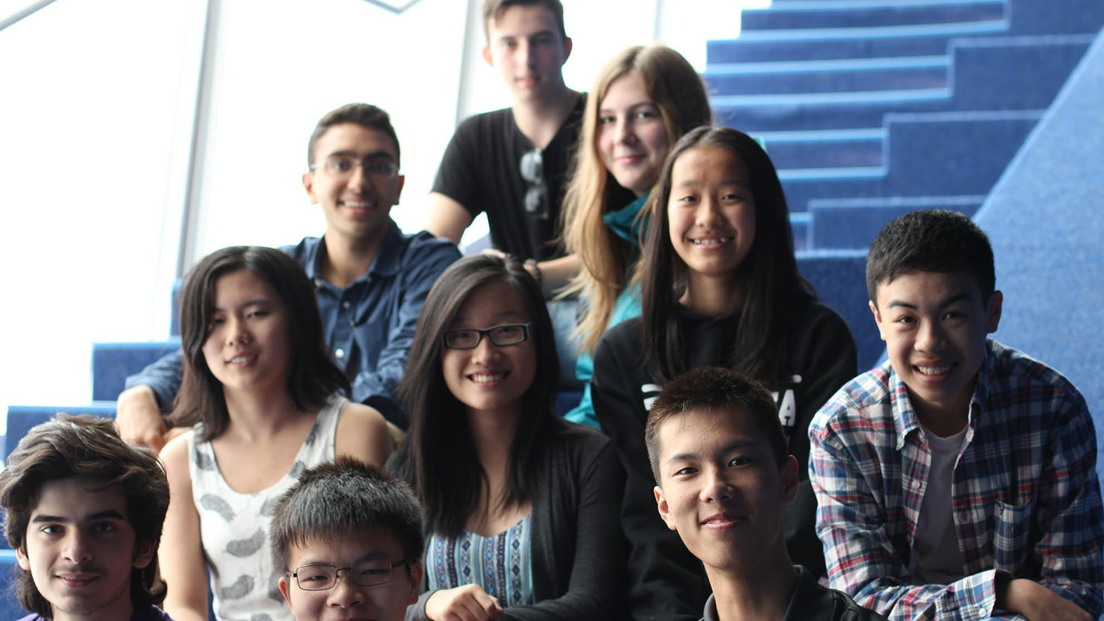 Photo of group of students smiling at camera.