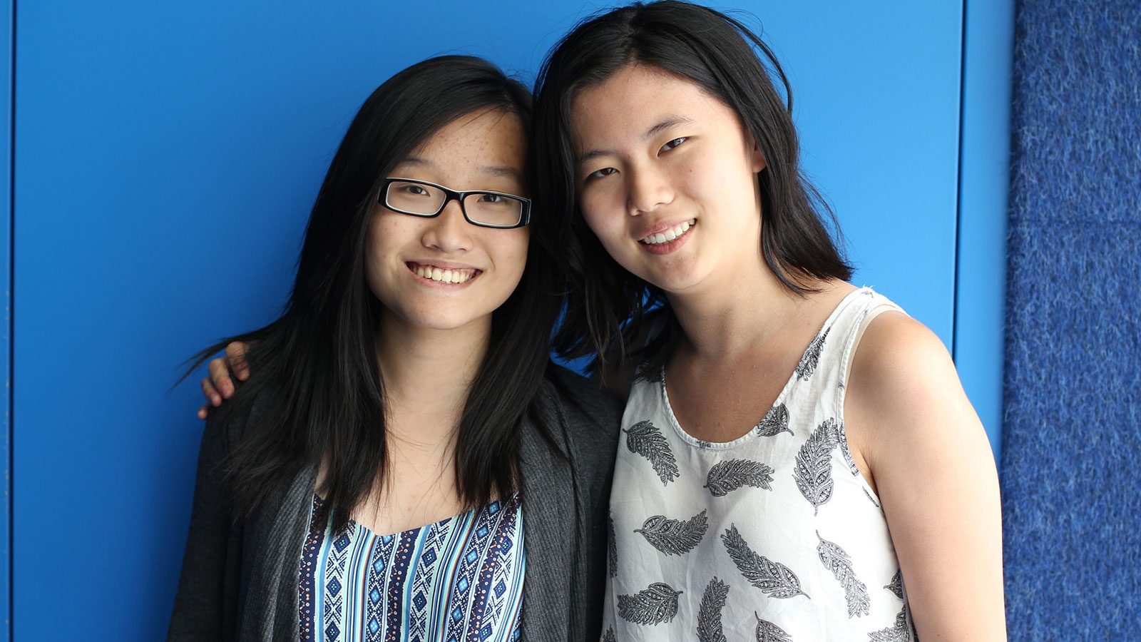 Photo of two students smiling.