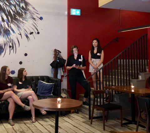 Photo of Leanna Vu and Stephanie Fielding presenting on stairs at Policy 'n Pub event.